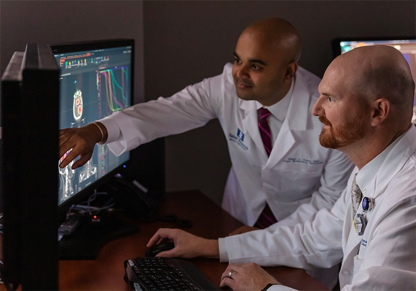 Doctors Patel and Goodman review a scan