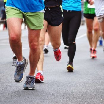 Runners compete in a road race
