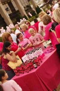 Girls examine the shopping options at the Pink Up event