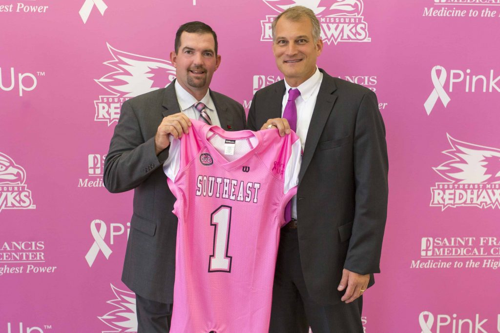 "Southeast football head coach Tom ""Tuke"" Matukewicz and Saint Francis Foundation executive director Jimmy Wilferth unveil the pink jerseys players will wear during the Pink Up football game on October 31. Bids may be placed through October 12 at www.pinkupcape.com."