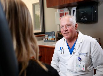 D. Curtis Coonce, MD, FACS consults with a patient