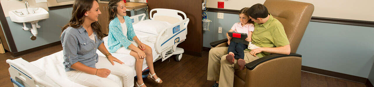 A family visit in an inpatient rehabilitation room