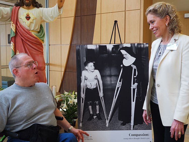 Dave Faris chats with Saint Francis Healthcare System CEO Maryann Reese