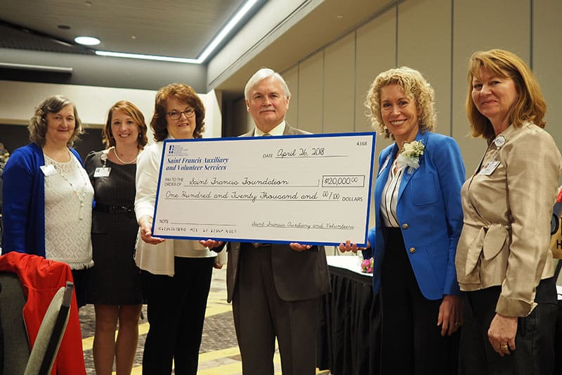 Saint Francis officials pose with a check for $120,000. The money will be used by the Saint Francis Foundation to fund scholarships and other community projects. Pictured, from left, are Donna McLain, Danielle Torbet, Judi Owens, Don Kaverman, Maryann Reese, and Christy LeGrand.
