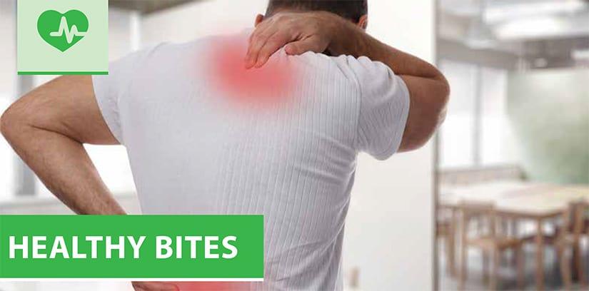 A man rubs his sore back muscles