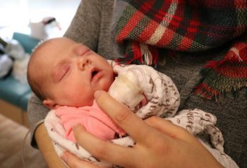 Baby Jovana is held by her mother in the NICU at Saint Francis Healthcare.