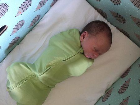 Nolan Blattel sleeps in a boxinette