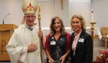 The Most Reverend Edward M. Rice, Bishop of the Springfield-Cape Girardeau Diocese, and Maryann Reese, President and CEO of Saint Francis Healthcare System, present the 2019 Sister Jane Mission Award to Pan Kimbel