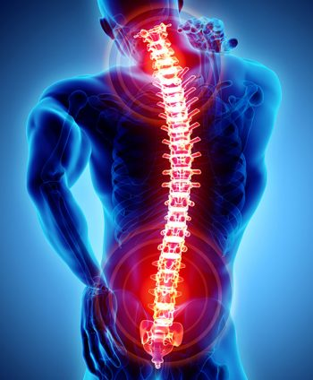 A man winces due to back pain