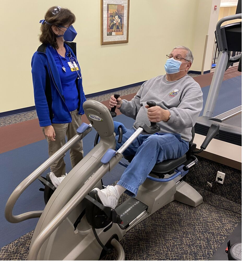 A Cardiac Rehab patients exercises on a stationary bike