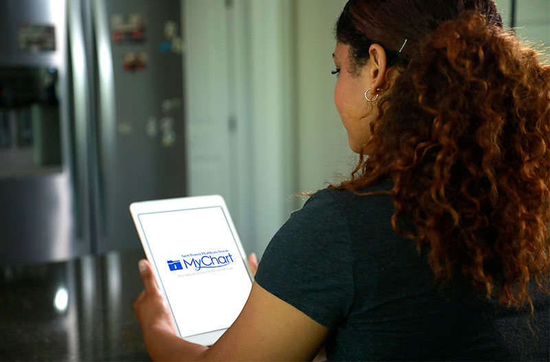 Woman accesses MyChart with a tablet